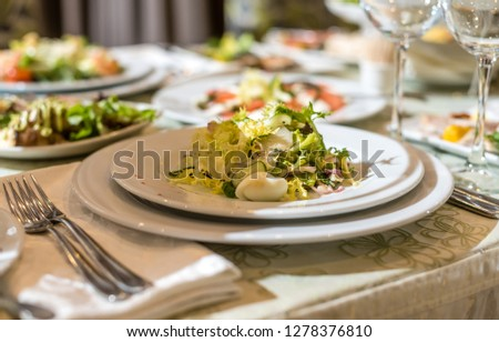 Serving dishes in the restaurant. luxury dinner served on the table #1278376810