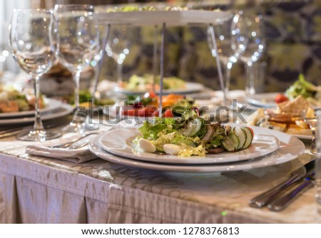 Serving dishes in the restaurant. luxury dinner served on the table #1278376813