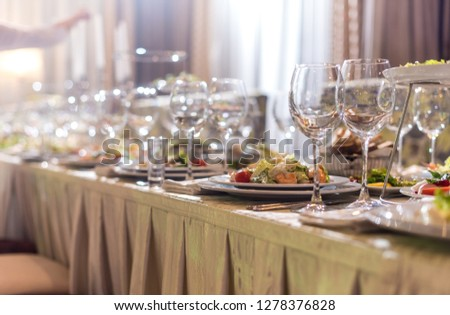 Serving dishes in the restaurant. luxury dinner served on the table #1278376828