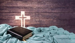 serving God, bible and cross on blue background Christian concept. copy space.