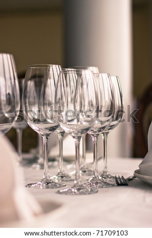 Serving luxury glass goblets on table in restaurant
