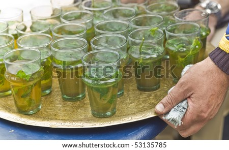 Serving mint tea in a restaurant in Morocco