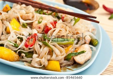 Serving of oriental warm noodle chicken salad