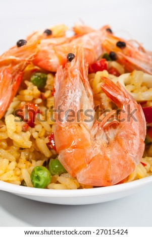 serving of spanish paella on white background