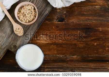 sesame milk sesame seed in a glass on wooden background, concept of healthy eating, organic food, gluten-free and aslacton vegetable milk. #1029359098