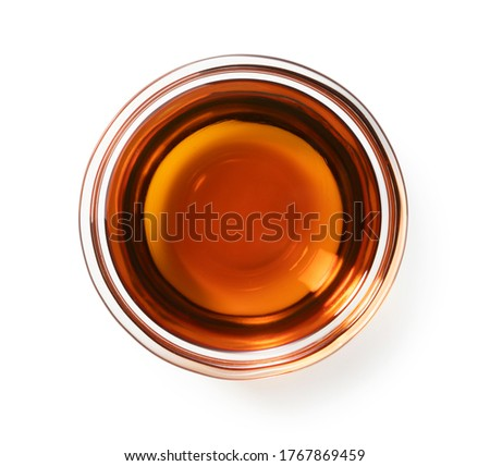 Sesame oil in a glass bowl set against a white background Foto stock ©