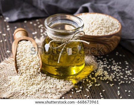 Sesame oil in glass and seeds Stockfoto ©