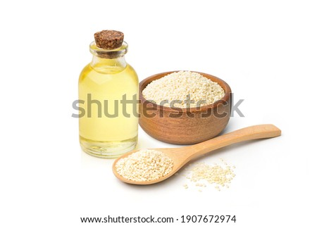 Sesame oil with white sesame seeds in wooden bowl and wooden spoon isolated on white background. Foto stock ©