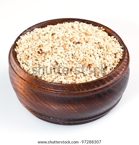 Sesame seeds in the plate isolated on white background.