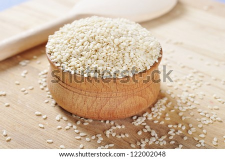 Sesame seeds in wooden bowl closeup