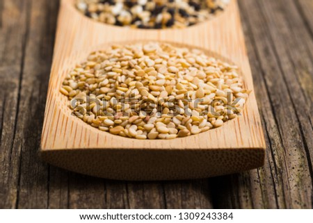 sesame seeds, old wooden table #1309243384