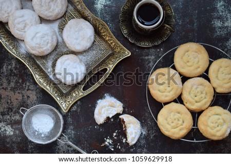 Sesame shortbread with date stuffing. Middle Eastern cookies. Eid and Ramadan Dates Sweets. Kahk. Arabian cuisine. Copy Space