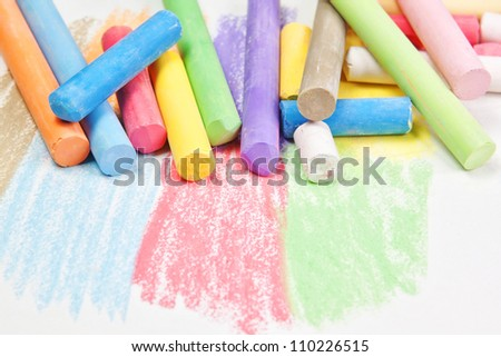 Set against the backdrop of chalk drawing.