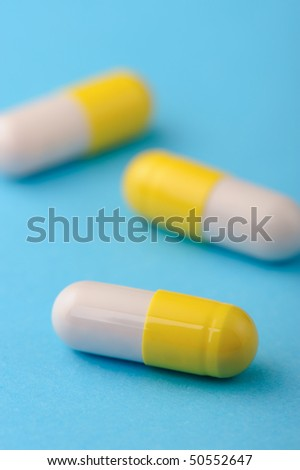 set capsules on blue background. Photo closeup