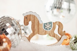 Set Christmas tree toys horse and disco ball in the snow.