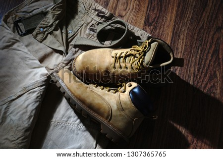 Set consisting of tourist pants and boots. Sandy pants and boots. Clothes for tourism and travel. Pants. Boots. Yellow pants and boots.                                #1307365765