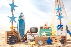Set design on beach for summer surf fishing photobooth