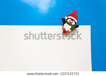 Set design template New Year's discount banner. Christmas poster with a cute penguin for sale. Happy holiday offer with penguin wearing a scarf and with cartoon gift. Xmas advertising for sale.