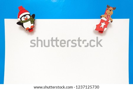 Set design template New Year's discount banner. Xmas advertising for sale.  elk and penguin on blue and white background
