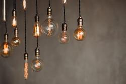 Set edison retro lamp on loft gray concrete background. Concept idea