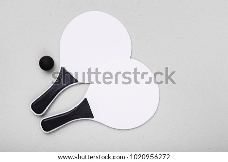 set for a game of beach tennis isolated on the white background wooden white racket pong