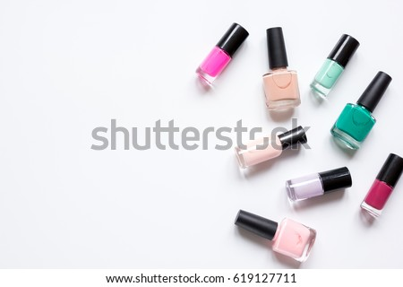 set for nail polish on white table background top view mock up #619127711