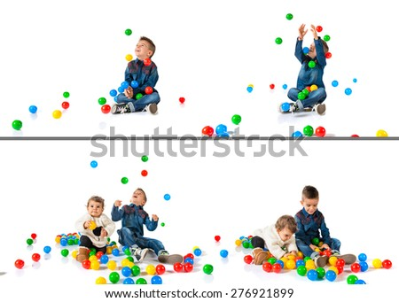 Set images of brothers playing with colored balls