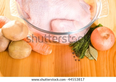 Set  ingredients for soup:  chicken and vegetables