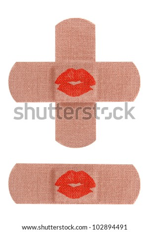 Set of adhesive medical bandages or bandaids with red kisses isolated on white background.