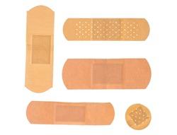 Set of adhesive plasters isolated on white background