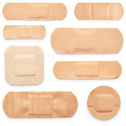 Set of adhesive plasters isolated on white background