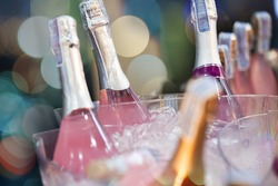 Set of Alcohol bottles in an ice bucket with Bokeh
