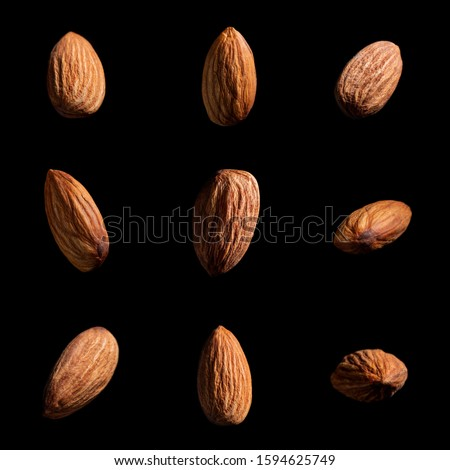 Set of almonds on black background. Different angles of popular tree nuts, healthy and nutritious ingredient.