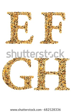 """Set of Alphabet """"E F G H"""" made by putting grain on isolate white background. A beautiful capital letter """"E F G H"""" made from cereal of birds food.You can see another letter in my portfolio. #682528336"""