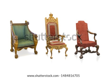 Set of ancient golden armchairs isolated on white background