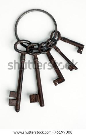 Set of antique old  keys over white background