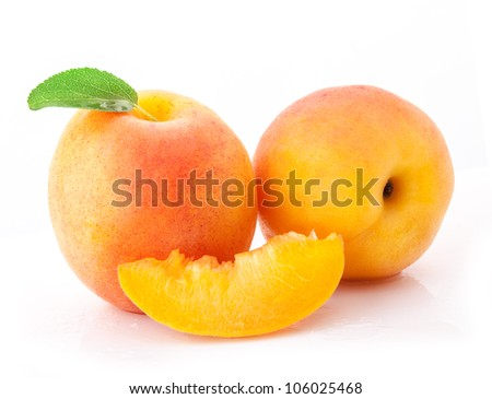 Set of apricot fruits and slices with green leaves, isolated on white background
