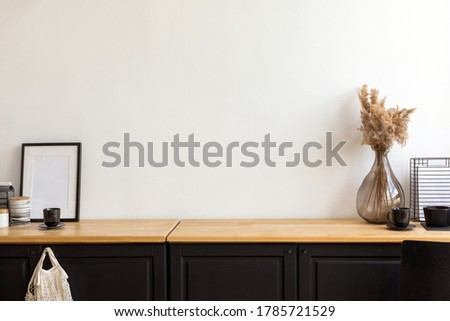Set of assorted decorations and accessories placed on cupboard against white wall in cozy room at home Stock photo ©