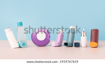 Set of asthma inhalers for asthma and COPD patients on table. Pharmaceutical product is used to treat lung inflammation and prevent asthma attack symptoms. Health care and medical concept. Copy space. Stock photo ©