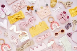 Set of  baby girl accessories on pink background. Various head band and hair bow, toy, little shoes, socks. Fashion kids stuff and accessories. Flat lay, top view