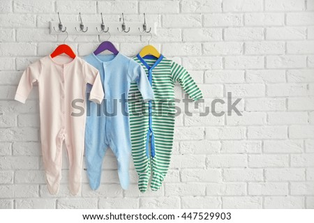 Set of baby romper on brick wall