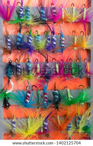 set of baits of multi-colored feathers for fishing, close-up background #1402125704