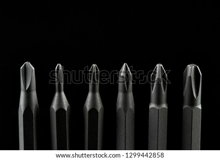 Set of bits for screwdriver. Metal bits for screwdriver. Tool set for household use. Nozzles and adapters for screwdrivers. Head different size hex driver.