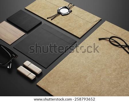 Set of black craft identity elements on black paper