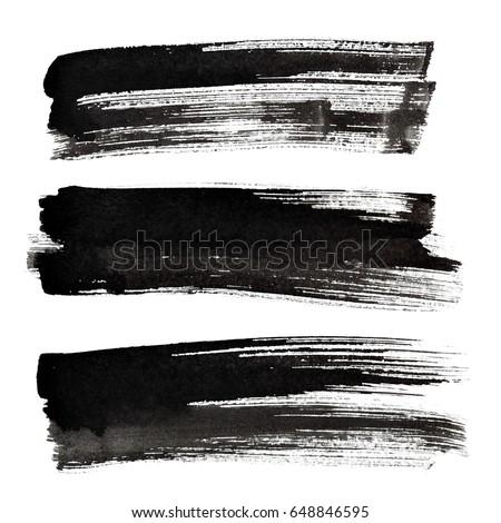 Set of black ink brush strokes isolated on the white background
