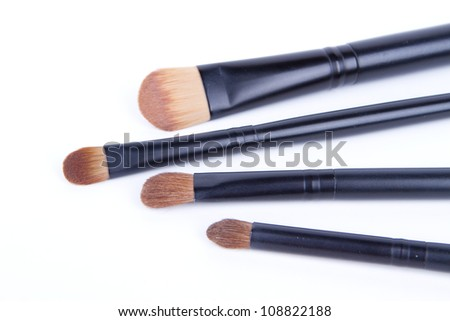 Set of black make-up brushes on white background