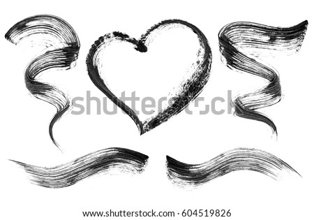Shutterstock Set of black mascara strokes close-up, isolated on white background