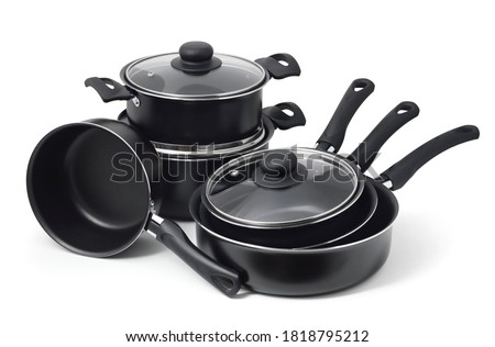 Set of black non-stick kitchen utensils on a white background. Pot, ladle, frying pan  with glass lid. Foto stock ©