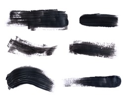Set of black paint strokes isolated on white background.