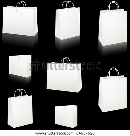Set of blank white paper shopping bags isolated on black